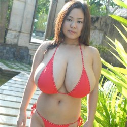 Busty Asian Girl in string Bikini