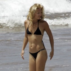 Kate Hudson at the beach in a skimpy black bikini