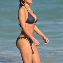 Kim Kardashian at the beach in a crazy bikini