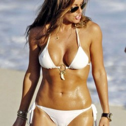 Rachel Uchitel in a crazy white bikini