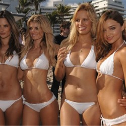 4 models wearing white bikinis