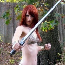 Redhead crazy bikini girl with sword