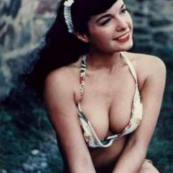 Bettie Page in a white bikini