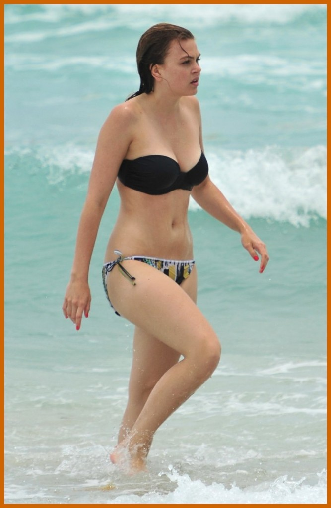 Aimee Teegarden in a black bikini