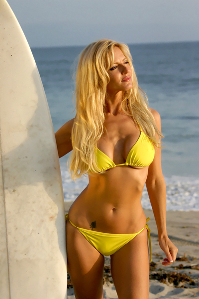 Blonde Woman holding a Surfboard in a Bikini, Surer Girl