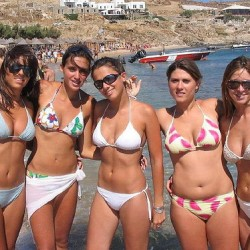 5 Girls in bikinis at beach